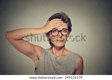Sad worried woman with headache thinking looking for solution