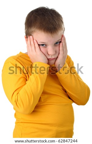 Sad 10 year old boy holding his cheeks isolated on white - stock photo