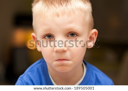 Sad young boy - stock photo