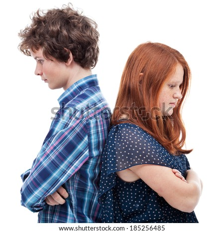 Sad young couple standing back to back - close-up - stock photo