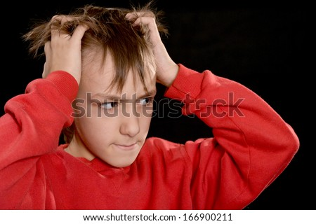 sad young fellow in red on a black background - stock photo