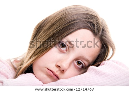 sad young girl, pre-teen portrait closeup isolated on white - stock photo