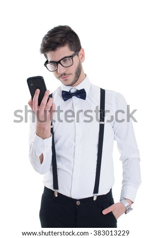 Sad young man looking at mobile phone - stock photo