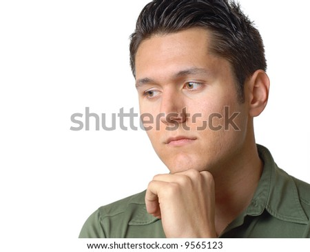 Sad young man sitting alone and thinking - stock photo