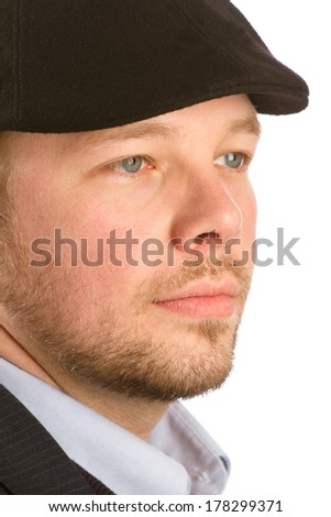 Sad Young Man - This is a photo of a sad young male wearing a hat looking away. Shot on an isolated white background. - stock photo
