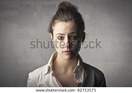Sad young woman - stock photo