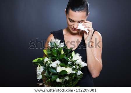 sad young woman in mourning clothes and crying - stock photo