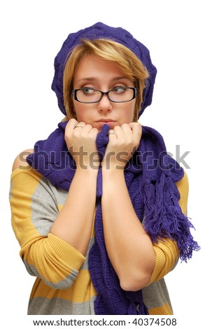 Sad young woman in violet beret isolated over white background - stock photo