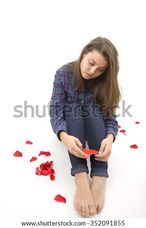 sad young woman over white background - stock photo