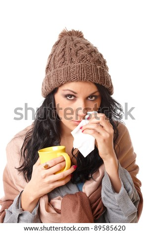 sad young woman with flu symptom holding a mug with a hot drink isolated on white background - stock photo