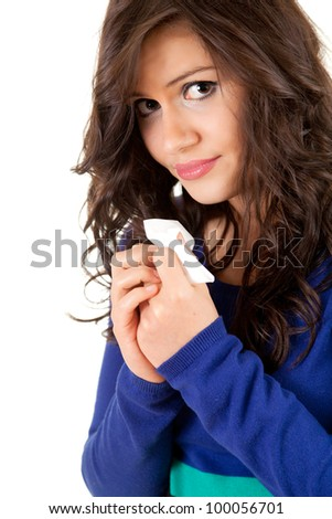 sad young woman with tissue, white background