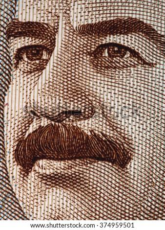 Saddam Hussein face on 25 dinars Iraq banknote extreme macro, Iraqi money closeup - stock photo