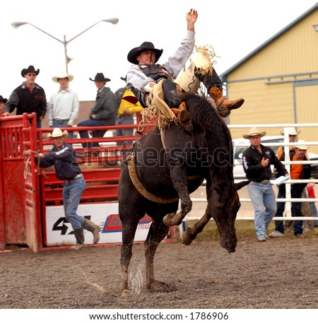 Saddle Bronc riding at the Help A Child Smile Rodeo Sept. 3/2006 in Welland, Ontario, Canada - stock photo