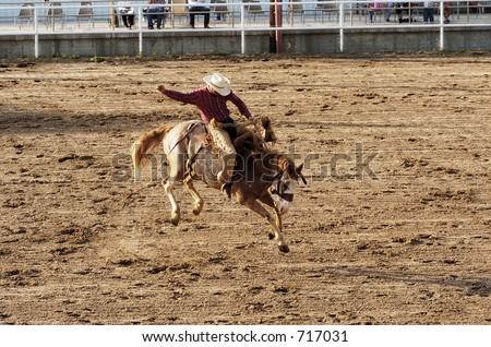 Saddle bronc riding rodeo competition. - stock photo