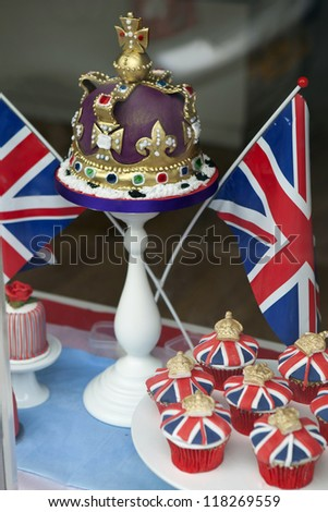 SADDLEWORTH, GREAT BRITAIN - JUNE 1:  Festive cakes in a small cake shop window display to celebrate Queen's Diamond Jubilee in Saddleworth village, UK  on June 1, 2012. - stock photo