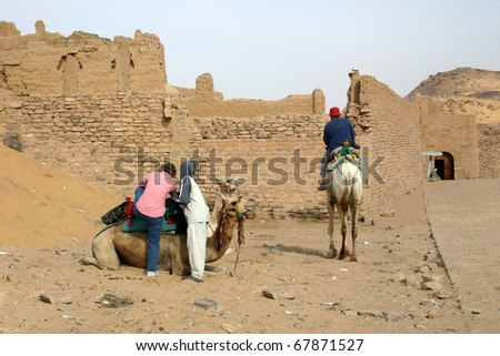 Saddling Up for a Camel Ride at St. Simeon's Monastery, Aswan, Egypt