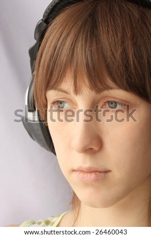 Sadly young woman with headphones