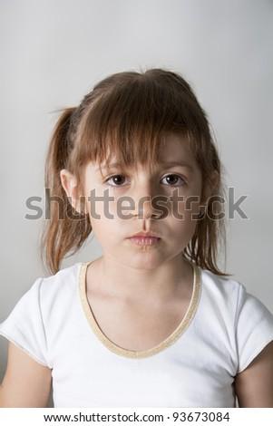 Sadness little girl. White grey. - stock photo