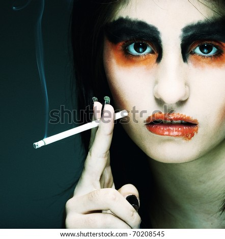 Sadness. Portrait young woman in depression.Creative make-up. - stock photo
