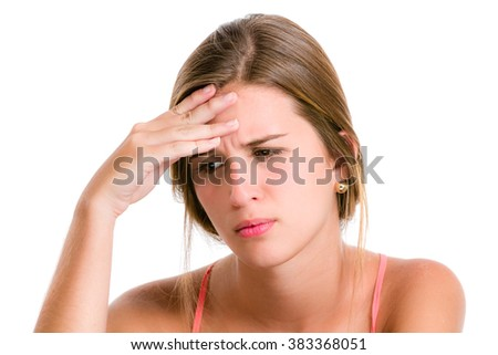 Sadness, sorrow, worries in a Hispanic young woman about to cry looking down and hands on face.  - stock photo