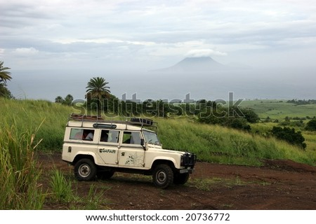 Safari Truck off road with Volcanic Island in the background