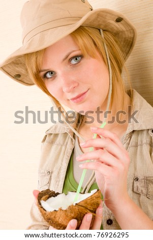 Safari young woman drink with straw from coconut - stock photo