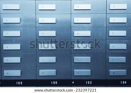 Safe deposit boxes in a bank vault. Blue tone image. - stock photo