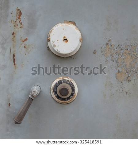 Safe lock code on vintage safety box bank - stock photo