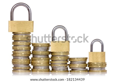 Safe money. Coins and padlocks isolated on a white background - stock photo