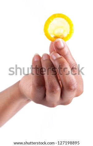 Safe sex concept. African woman Hand with condom, isolated on white background