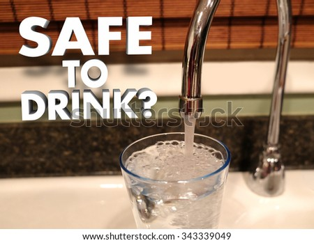 Safe to Drink question in 3d words beside a faucet pouring water in a glass - stock photo