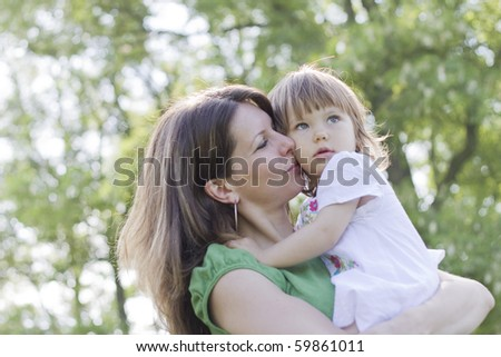 Safe with my mother - stock photo