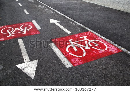 Safety and careful bike path crossing signs. - stock photo