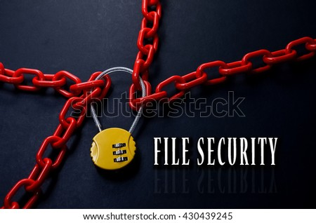 Safety Concept. Red chain and yellow padlock with number combination on blackboard with word File Security. - stock photo