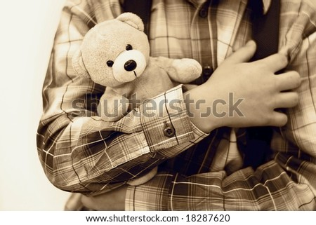 Safety concept. The boy is holding teddy bear - stock photo