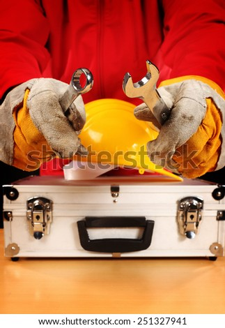 Safety equipment set and worker, close up - stock photo