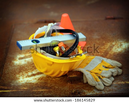 Safety equipment  set,  close up on rusty surface - stock photo