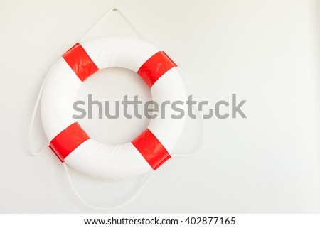Safety first. Red lifebuoy hanging on  wall  - stock photo