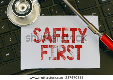 Safety first sign and stethoscope.Safety first sign and stethoscope. Medicine concept on computer keyboards - stock photo
