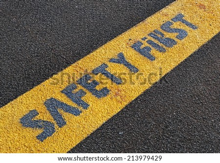 Safety First sign on yellow strip.
