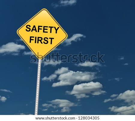 safety first traffic sign on blue sky - stock photo