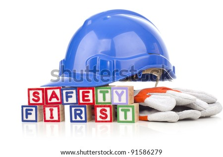 safety first word blocks with personal protective equipment isolated on white background - stock photo