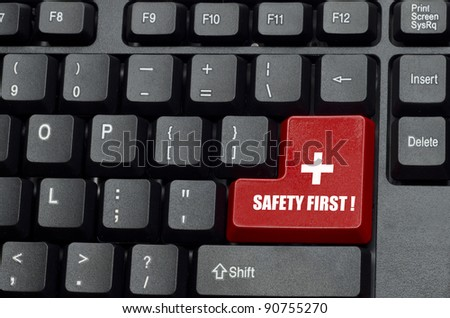 safety first word on red and black keyboard button - stock photo