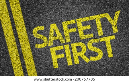 Safety First written on the road - stock photo