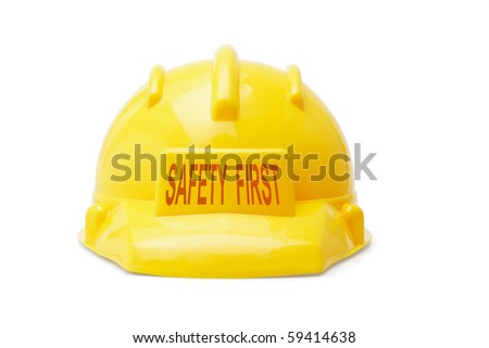 Safety First yellow hardhat on white background - stock photo