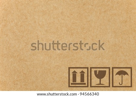 Safety fragile icon on cardboard paper box with space - stock photo