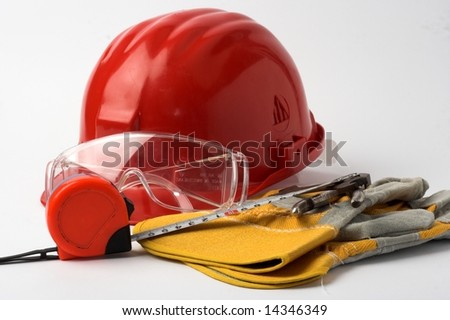 Safety gear and measuring tape - stock photo