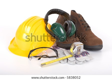 Safety gear and measuring tape - over a white background