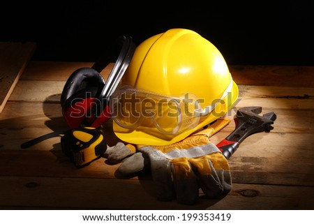 Safety gear kit close up in the spotlight - stock photo