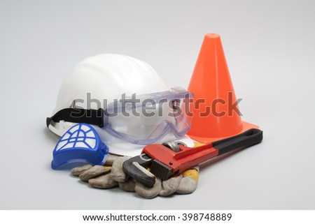 Safety gear kit close up on grey background